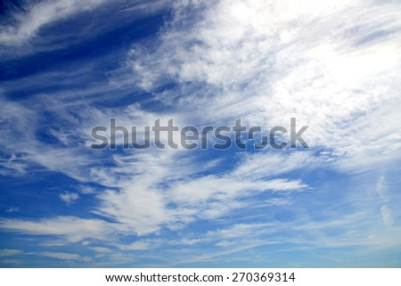 Light blue sky with clouds as background - stock photo