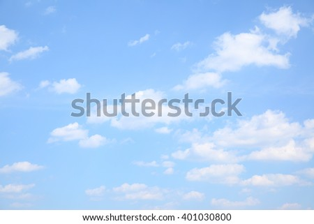 Light blue sky with clouds, may be used as background - stock photo
