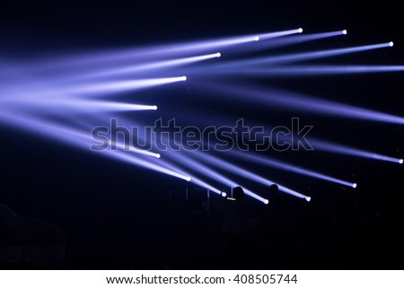 light blue spotlights empty stage concert show - stock photo