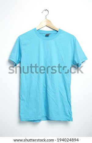 Light blue tshirt template on hanger ready for your own graphics. - stock photo
