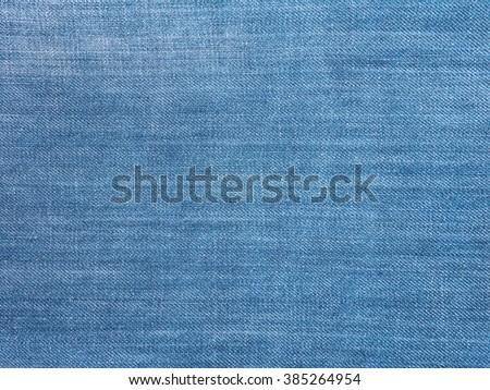 Light blue washed faded denim fabric background - stock photo