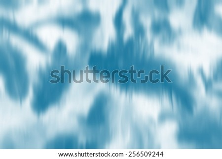Light blue white smudge blurry abstract background feathers like - stock photo