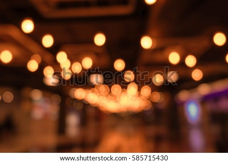 Light Blur Background With Bokeh In The Shopping Mall Dark Blurred