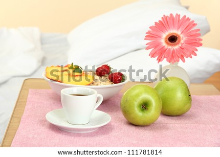 light breakfast on the nightstand next to the bed - stock photo