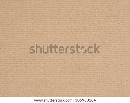 light brown corrugated cardboard texture useful as a background - stock photo