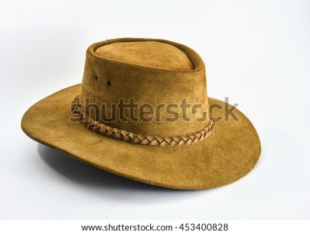 Light brown cowboy hat made of real leather on white background. - stock photo
