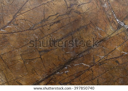 Light brown marble, chaotic rugged dark brown and beige stripes. Natural materials for interior decoration. Natural stone for use in interior design. Bidasar Brown. Rainforest Brown.  - stock photo
