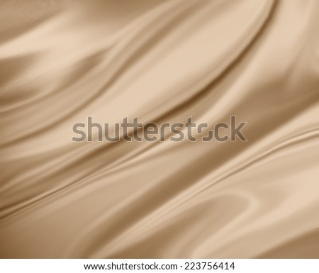 light brown or gold background abstract cloth or liquid wave illustration of wavy folds of silk or satin texture, luxurious background design - stock photo