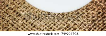 light brown part of canvas background with horizontal and vertical lines. classik light ivory brown country fabric background