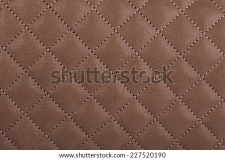 Light brown quilted leather background - stock photo
