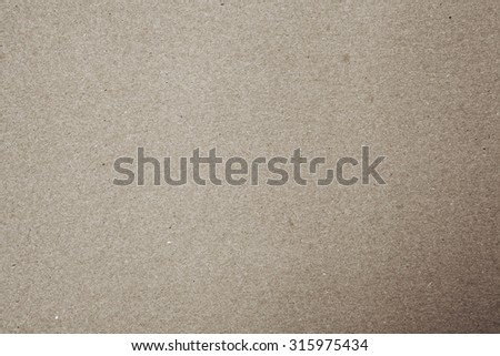 Light brown still life paper sheet texture background with grain noise dirt and specs effect, full frame. Close up detail of a textured blank page monotone color organic art paper. Beige background.