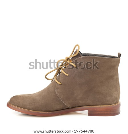 Light brown suede boot isolated on white background.