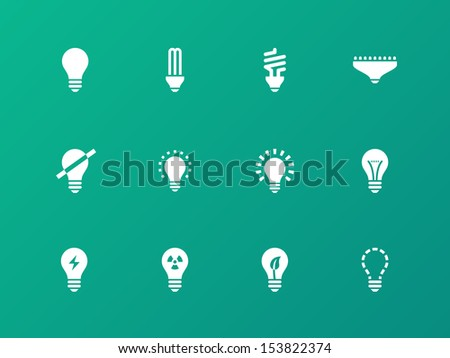 Light bulb and CFL lamp icons on green background. See also vector version. - stock photo