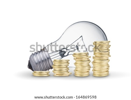 Light bulb and coins. Isolated on white background - stock photo