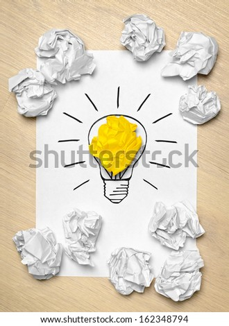 Light bulb crumpled paper as creative concept - stock photo