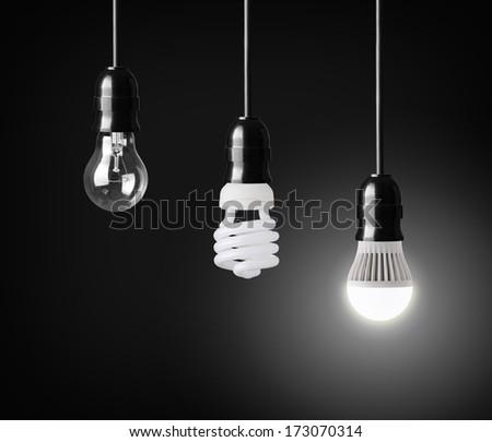 Light bulb,energy saver bulb and LED bulb on black - stock photo