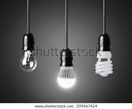 Light bulb,energy saver bulb and LED bulb on black - stock photo