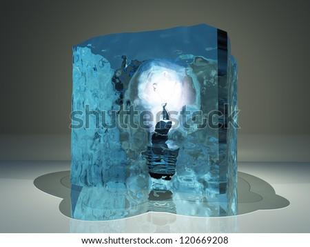 Light bulb frozen in ice - stock photo