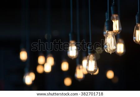 light bulb glowing in the dark - stock photo