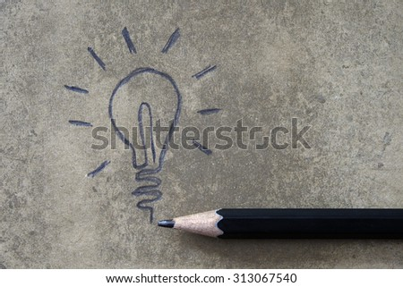 Light bulb icon with concept of idea.Drawing with pencil,grunge background - stock photo