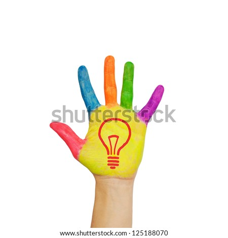 Light bulb (idea concept) on a colorful child's hand. Isolated on white background. - stock photo