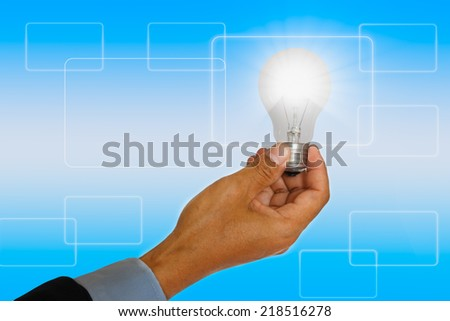 Light bulb Ideas on concept solution on background(success in their hand). - stock photo
