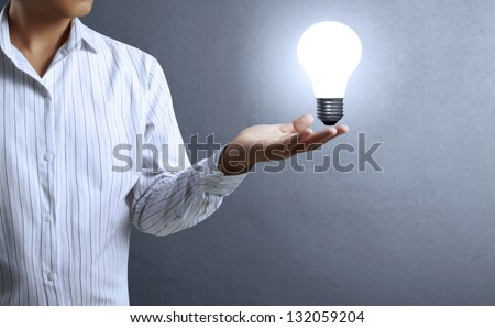 Light bulb, in a hand Business man - stock photo