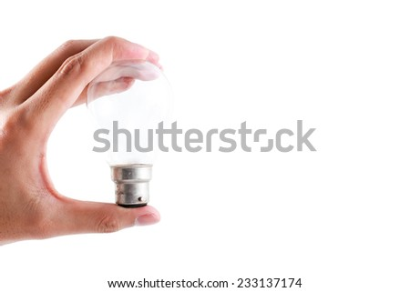 Light bulb in a hand isolated on white background. - stock photo