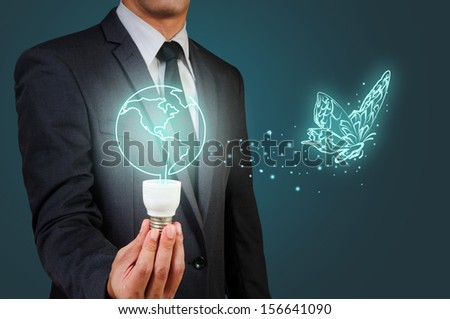 Light bulb in businessman s hand