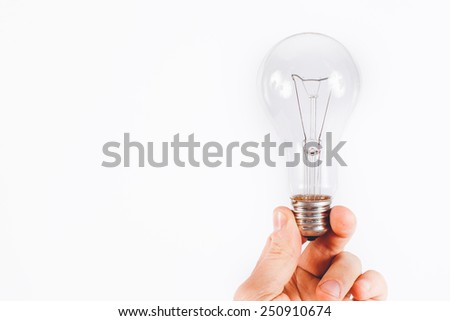 light bulb in hand on a white background - stock photo
