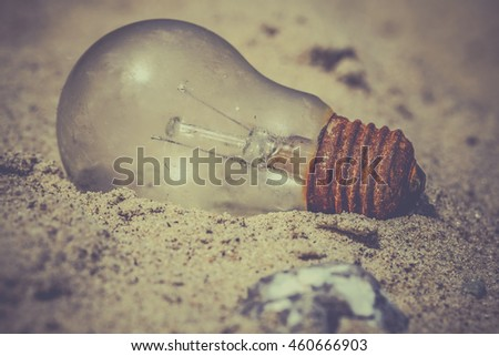 Light bulb in the sand