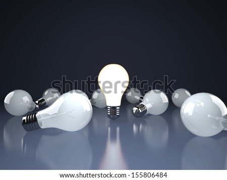 Light bulb lamps on a dark background - stock photo