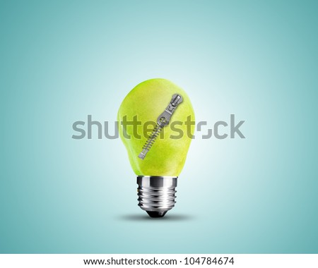 light bulb made from Green Pear with zipper, light bulb conceptual Image. - stock photo