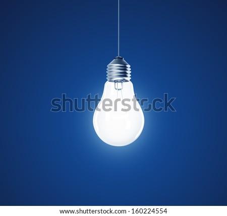 Light bulb on blue background - stock photo