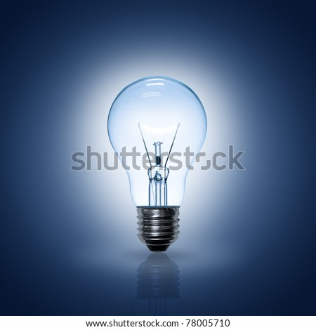 Light bulb on blue background. - stock photo