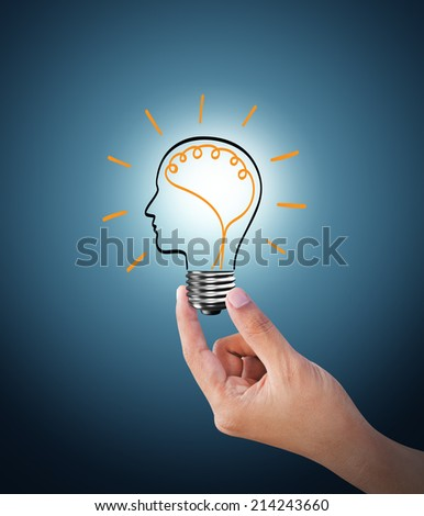 Light bulb on blue background, the concept of the emergence of the idea - stock photo