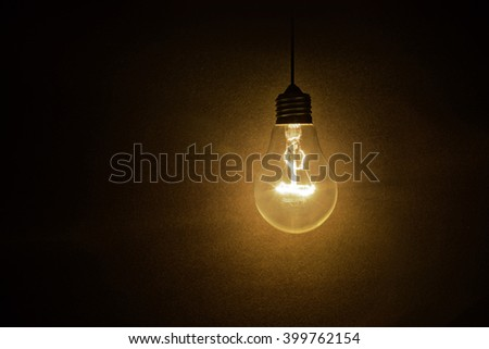 light bulb on dark background, concept of creativity. - stock photo
