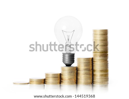 light bulb on gold coins and graph them isolated on white background