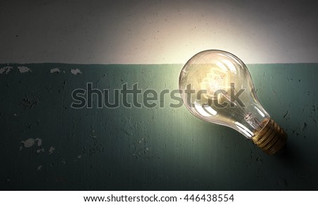 Light bulb on stone surface . mixed media