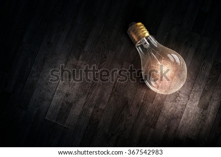 Light bulb on wooden surface