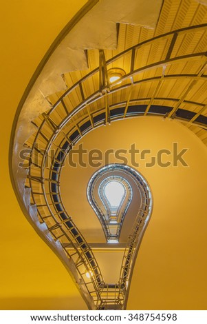 light bulb shaped cubism staircase in historical building in the centre of old Prague in black and white. Czech. - stock photo