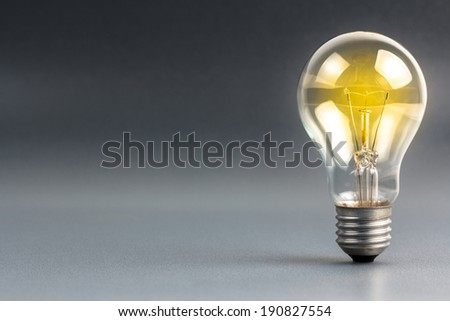 Light bulb shining  with copy space - stock photo