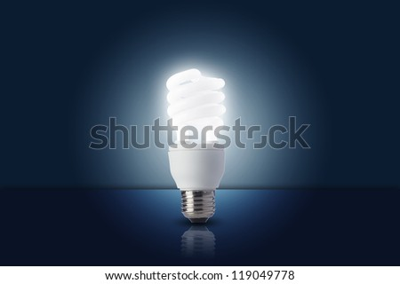 Light bulb turn on in dark room - stock photo