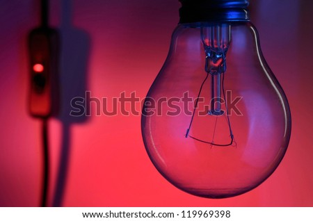 Light bulb turned off on a night scene background - stock photo