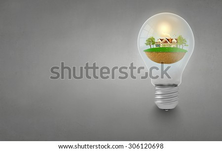 Light bulb with concept of ecological construction in it