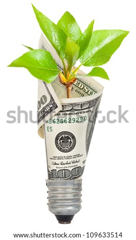 Light bulb with dollar and green sprout - stock photo