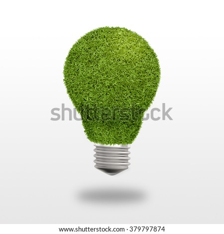 Light bulb with grass instead of glass on a white background