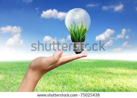 light bulb with hand