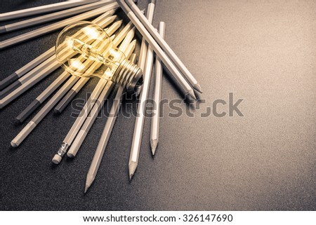 Light bulb with many pencils - stock photo