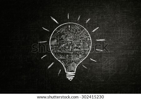 Light bulb with sketches inside on dark background